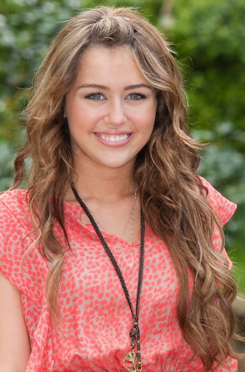 Miley cyrus casual messy curly updo hairstyle hairstyles weekly.