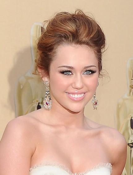 Miley cyrus loose bun hairstyles weekly miley cyrus loose bun pmusecretfo Images
