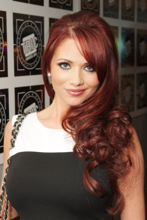 Amy Childs Red Curly Hairstyle with Side Bangs
