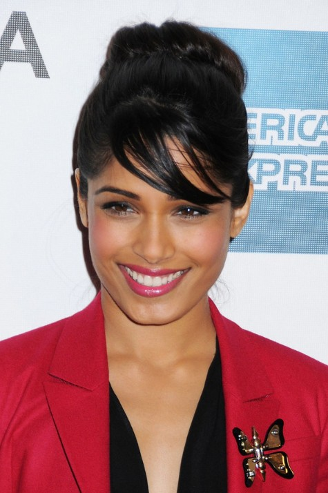Freida Pinto Cute Black Loose Bun Updo with Side Swept Bangs