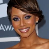 Keri Hilson Stylish French Twist Updo Hairstyle for Black Women