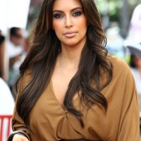 Kim Kardashian Layered Long Wavy Hairstyle