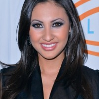Francia Raisa Long Black Hairstyle with Layers