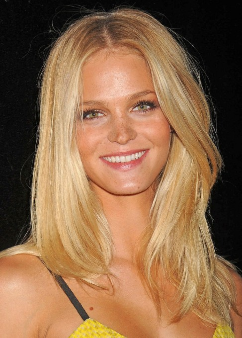 Long Blonde Wavy Hairstyle with Tousled Layers