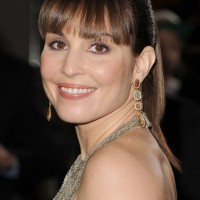 Noomi Rapace Long Sleek Ponytail Hairstyle with Blunt Bangs
