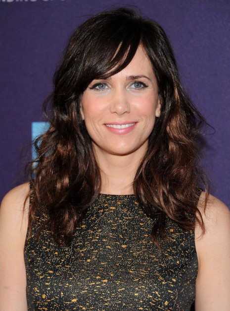 Kristen Wiig Long Wavy Hairstyles with Side Swept Bangs