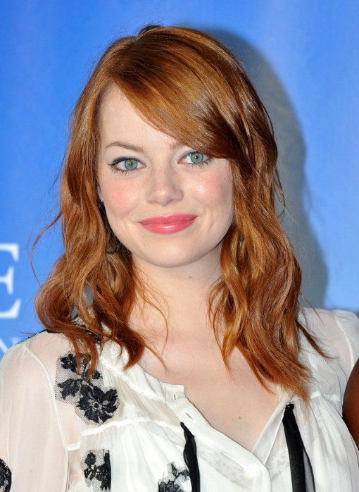 Emma Stone Medium Brown Wavy Hairstyle with Side Bangs