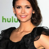 Nina Dobrev hairstyles: Bobby Pinned Low Side Bun Updo