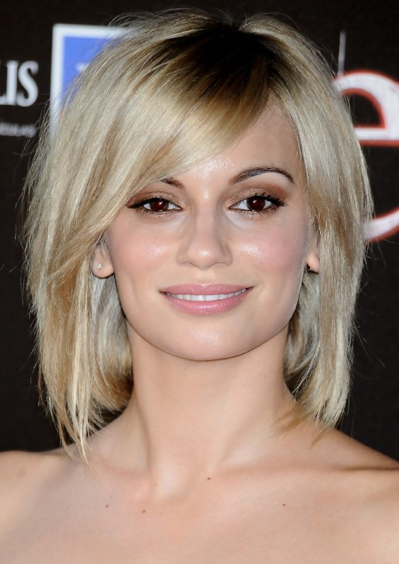 Norma Ruiz short hairstyle with long side swept bangs