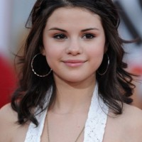 Selena Gomez Cute Braided Half Up Half Down Hairstyle for Girls