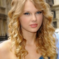 Taylor Swift Long Curly Hairstyle with Side Swept Bangs 2013
