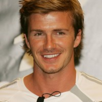 Medium Layered Hairstyles for Men: Cool Layered Hairstyle from David Beckham