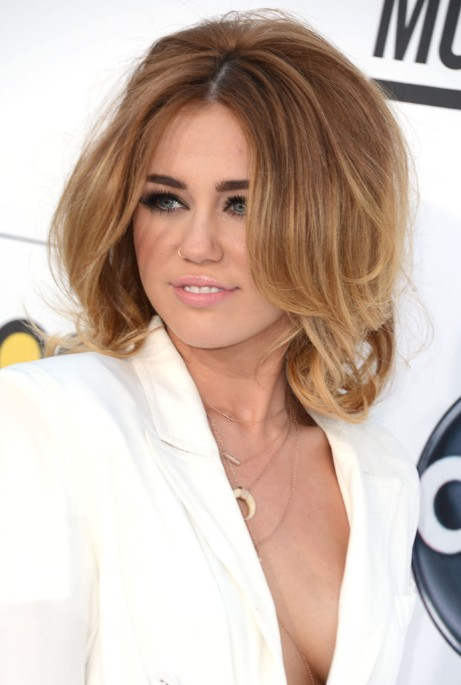 Miley Cyrus Layered Medium Length Hairstyles/Getty Images