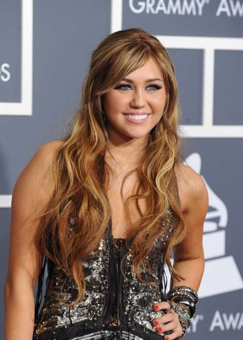 Miley Cyrus Long Caramel Hairstyles With Side Swept Bangs