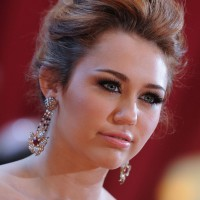 Miley Cyrus Loose Messy Bun Updo Romantic Updos for Wedding