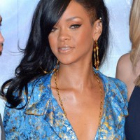 Rihanna Long Hairstyles: Black Wavy Hair Style with Side Swept Bangs