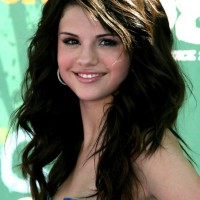 Selena Gomez Long Hairstyles: Long Wavy Hair with Side Bangs