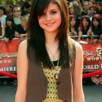 Girls Hairstyles: Selena Gomez Long Sleek Hairstyle with Side Bangs