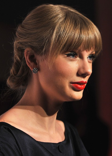 Taylor Swift Braided Updo with Sleek Bangs