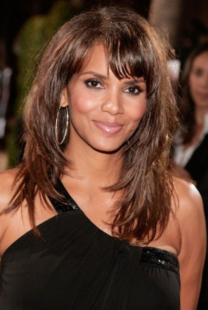 Halle berry layered long hairstyle with bangs