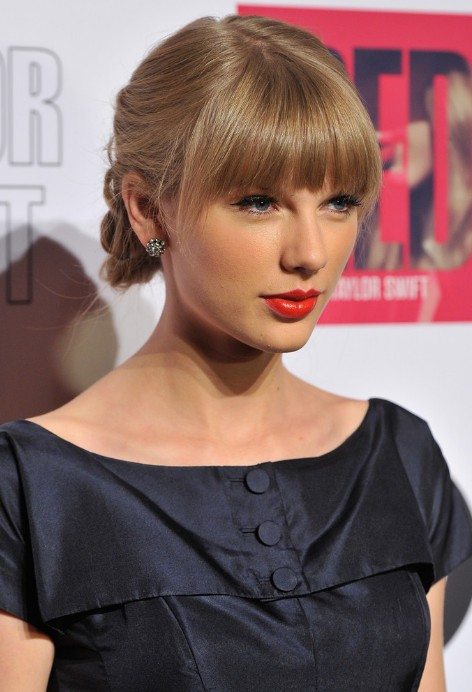 taylor swift tucked-under braid with blunt bangs - hairstyles weekly