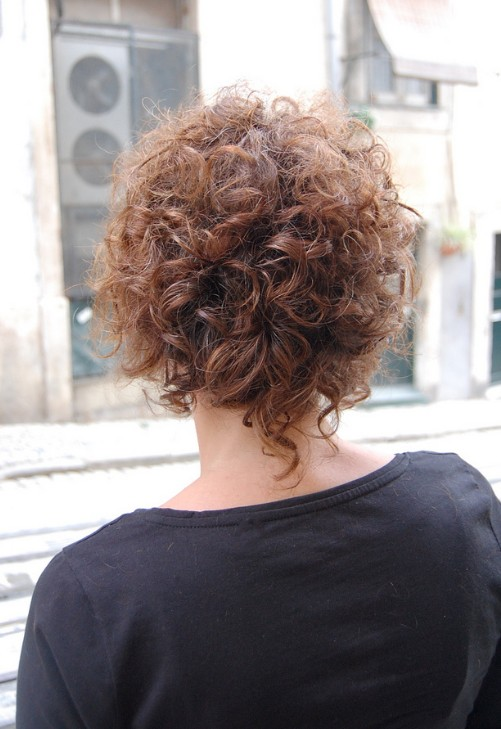 Back View of Feminine and Seductive Soft Curly Bob
