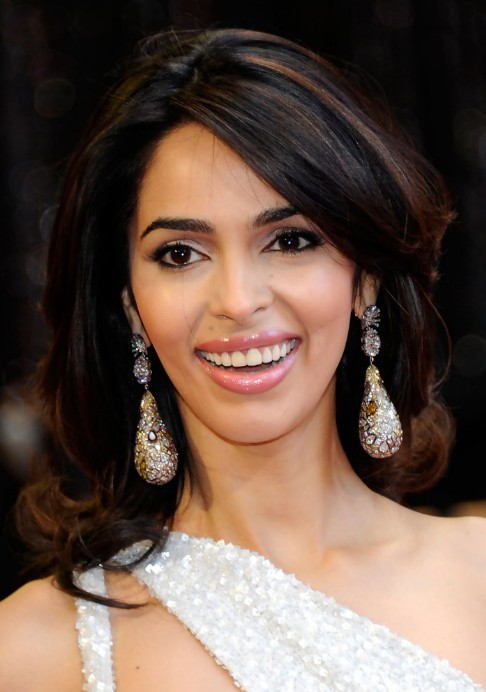 Mallika Sherawat Medium Layered Hairstyle with Bangs 2013