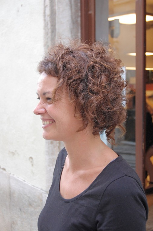 Side View of Feminine and Seductive Soft Curly Bob Haircut