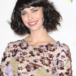 Kimbra Short Black Curly Hairstyle with Bangs