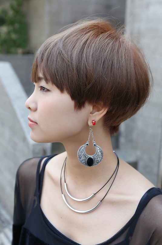 Side View of Cute Short Haircut with Bangs
