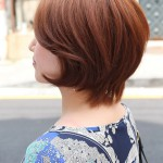 Side View of Short Auburn Haircut for Women