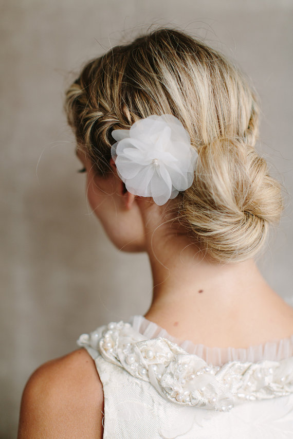 Romantic Low Braided Bun Updo With Silk Flower Hairstyles Weekly