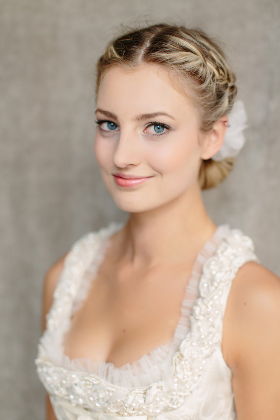 Fabulous Romantic Low Braided Bun Updo With Silk Flower Hairstyles Weekly Short Hairstyles For Black Women Fulllsitofus