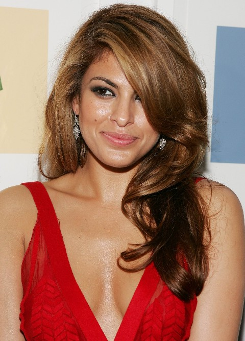 Eva Mendes Hairstyles: Sexy long wavy hair style with side swept bangs