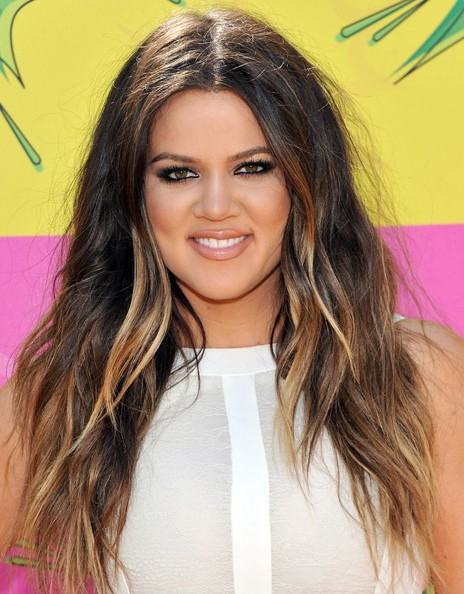 Khloe Kardashian layered long wavy hairstyle with highlights