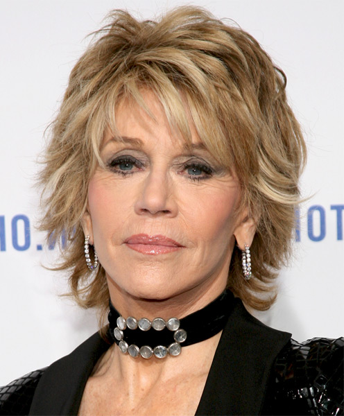 Jane Fonda medium layered blonde messy hairstyle with bangs for older women over 60