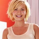 Shaggy blonde bob haircut with bangs - Elisha Cuthbert hairstyle