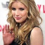 Messy center parted long blonde hairstyle Emma Roberts' hairstyle