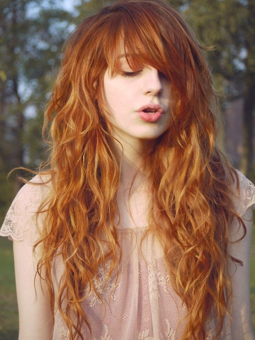 Orange Long Wavy Hairstyle with Messy Bangs