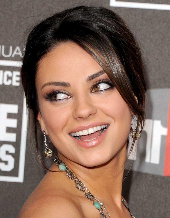 Super glossy dark brown updo from mila kunis hairstyles weekly mila kunis hairstyles elegant updo with side swept bangs pmusecretfo Image collections