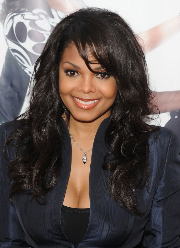 Janet Jackson Long Curly Hairstyle with Bangs for Black Women