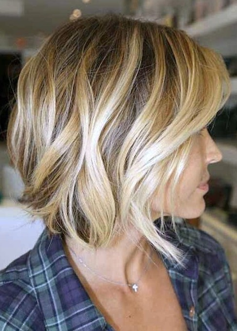 Groovy Side View Of The Angled Bob Hairstyle Wave Bob Haircut Short Hairstyles Gunalazisus