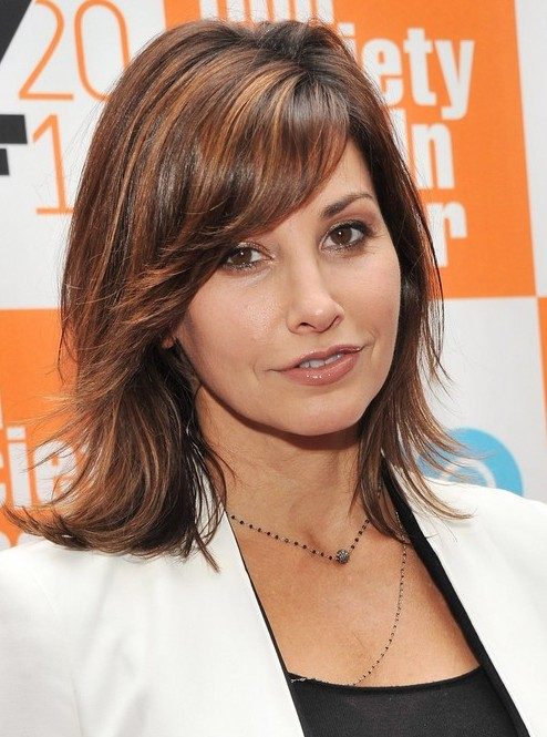 Gina Gershon Medium Wavy Hairstyle with Bangs for Thick Hair