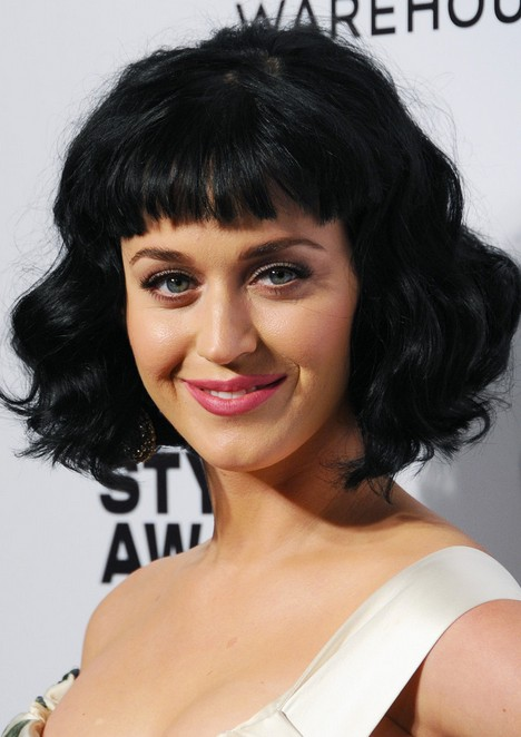 Katy Perry Short Black Wavy Hairstyle with Blunt Bangs for Women