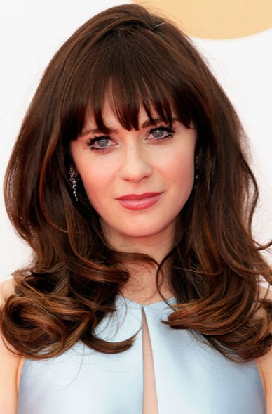 Hairstyle for thick hair layered brunette wavy hair with bangs