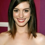 Long Bob (lob) hairstyle with side swept bangs for oval face shapes