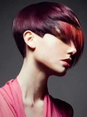 Red colored short haircut with long bangs