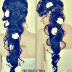 Romantic long curly hairstyle with flowers