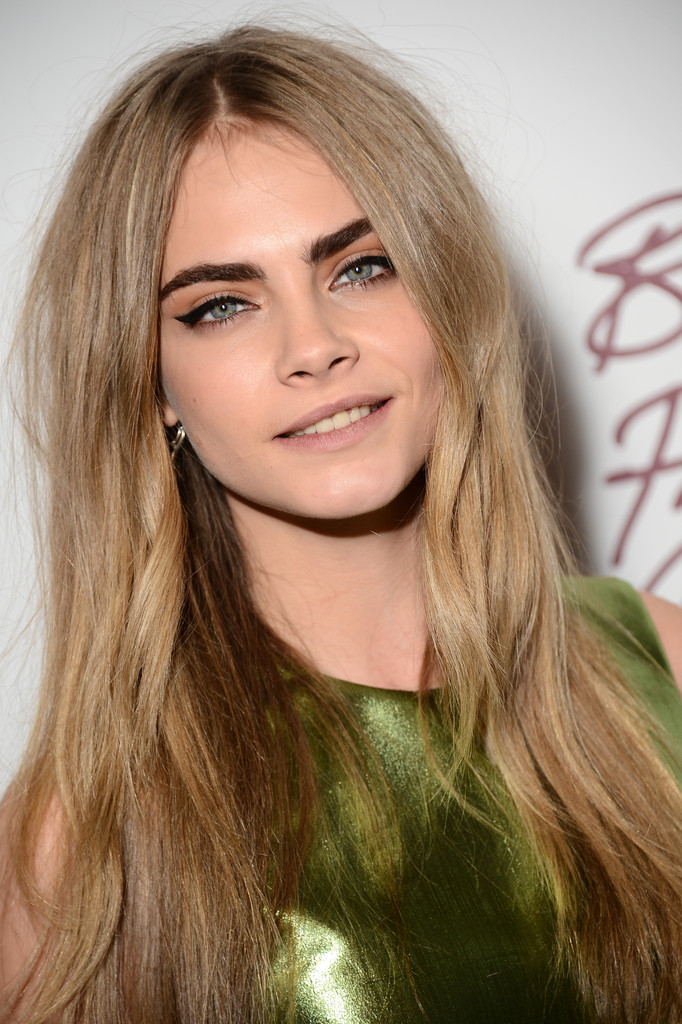 Cara Delevingne Long Center Part Hairstyle for 2016