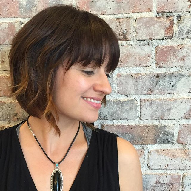 Pretty short bob hairstyle with bangs for women